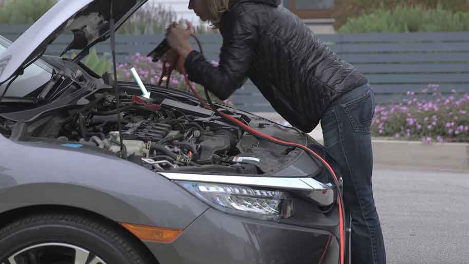 Detangling the Jumper Cable for Charging